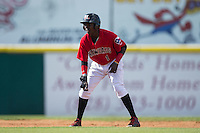 Michael De Leon (1) of the Hickory Crawdads takes his lead off of second base against the Savannah Sand Gnats at L.P. Frans Stadium on June 14, 2015 in Hickory, North Carolina.  The Crawdads defeated the Sand Gnats 8-1.  (Brian Westerholt/Four Seam Images)