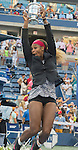 Serena Williams (USA) celebrates with the trophy after her  victory over Caroline Wozniacki (DEN)