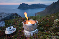 Flame from camping stove at twillight over Uttakleiv beach, Vestvågøy, Lofoten Islands, Norway