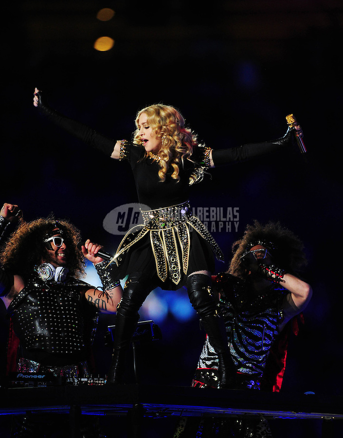 Feb 5, 2012; Indianapolis, IN, USA; Recording artists SkyBlu (left) and RedFoo (right) of LMFAO perform with Madonna (center) during the halftime show for Super Bowl XLVI between the New York Giants and New England Patriots at Lucas Oil Stadium.  Mandatory Credit: Mark J. Rebilas-.