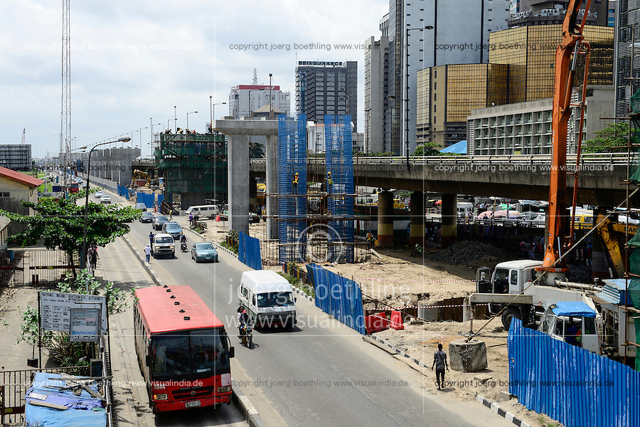 NIGERIA, City Lagos, business center and flyover construction for new metro train by chinese company CHINA CIVIL CCECC, road traffic
