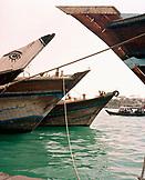 UNITED ARAB EMIRATES, Dubai, Dubai Creek, wooden Dhows used for transporting cargo parked along the Dubai Creek