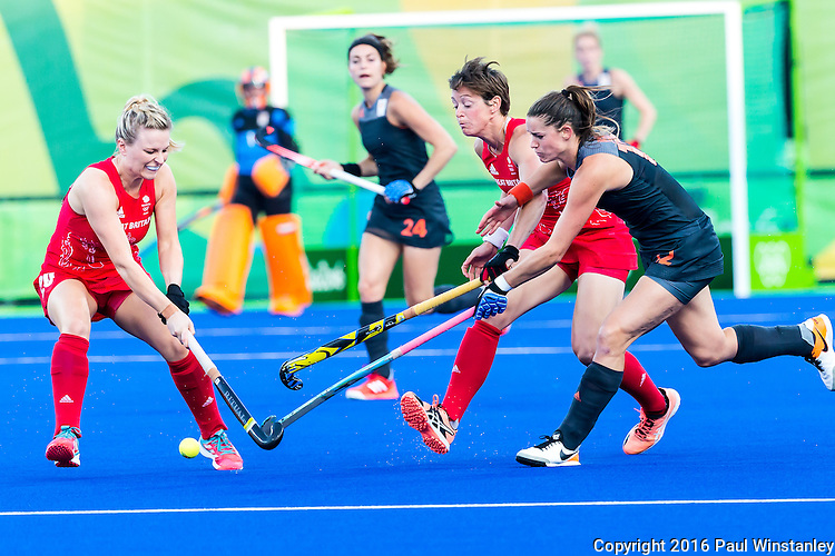 Lidewij Welten #12 of Netherlands, \GBR8 and Hollie Webb #20 of Great Britain contest for the ball during Netherlands vs Great Britain in the gold medal final at the Rio 2016 Olympics at the Olympic Hockey Centre in Rio de Janeiro, Brazil.