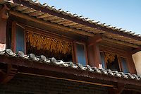 Corn drying in the eaves, Baisha Naxi Village, Lijiang, Yunnan, China. 10 November 2012.