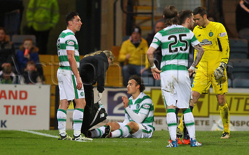 05.04.2016. Dens Park, Dundee, Scotland. Scottish Football Premiership Dundee versus Celtic. Erik Sviatchenko gestures to Celtic physio after picking up an injury . The game ended in a dull 0-0 draw.