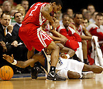 Dallas' Josh Howard, right, goes after the ball against Houston's Luther Head during an NBA basketball game on Friday, February 9, 2007.  (Star-Telegram/Khampha Bouaphanh)