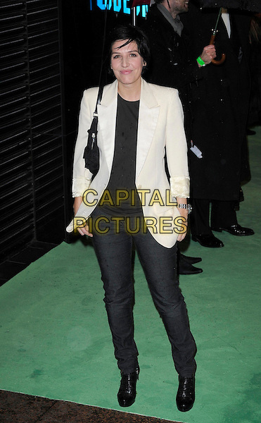SHARLEEN SPITERI.Royal World Film Premiere of 'Alice in Wonderland' at the Odeon Cinema, Leicester Square, London, England..February 25th, 2010 .arrivals full length black cream white jacket bag blazer top jeans denim .CAP/CAN.©Can Nguyen/Capital Pictures.