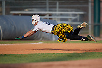 Savannah Bananas Gabe Howell (6) slides head first into third base after hitting a triple during a Coastal Plain League game against the Macon Bacon on July 15, 2020 at Grayson Stadium in Savannah, Georgia.  Savannah wore kilts for their St. Patrick's Day in July promotion.  (Mike Janes/Four Seam Images)