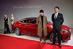 "March 14, 2016, Tokyo, Japan - Mercedes Benz Japan president Kintaro Ueno (R) and Japanese designer Yu Amatsu of ""Hanae Mori manuscrit"" with models stand next to Mercedes-Benz new C-class coupe at Mercedes' showroom in Tokyo on Monday, March 14, 2016 as Mercedes introduces the new coupe model on Japanese market. Tokyo fashion week sponsored by Merceds Benz started here on March 14 and runs through to the 19th.  (Photo by Yoshio Tsunoda/AFLO) LWX -ytd-"