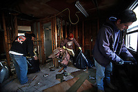 Contractors demolish a home one month after Hurricane Sandy hit town in Seaside Heights, New Jersey, November 28, 2012.