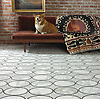 Solid Ovals hand crafted mosaic floor in Calacatta Tia and Nero Marquina