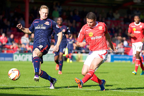 14.09.2013 Crewe, England. Crewe Alexandra Midfielder Bradden Inman and Walsall FC Sam Mantom in action during the League One game between Crewe Alexandra and Walsall FC from the Alexandra Stadium
