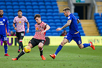 Billy Jones of Sunderland passes around Joe Ralls of Cardiff City during the Sky Bet Championship match between Cardiff City and Sunderland at the Cardiff City Stadium, Cardiff, Wales on 13 January 2018. Photo by Mark  Hawkins / PRiME Media Images.
