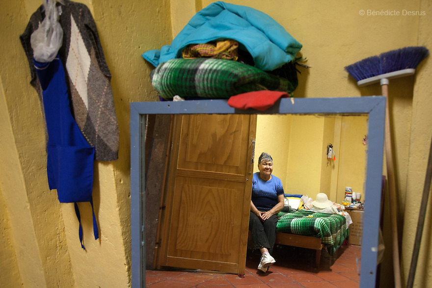 Portrait of Carmelita, a resident of Casa Xochiquetzal, in her bedroom at the shelter in Mexico City on November 1, 2012. Casa Xochiquetzal is a shelter for elderly sex workers in Mexico City. It gives the women refuge, food, health services, a space to learn about their human rights and courses to help them rediscover their self-confidence and deal with traumatic aspects of their lives. Casa Xochiquetzal provides a space to age with dignity for a group of vulnerable women who are often invisible to society at large. It is the only such shelter existing in Latin America. Photo by Bénédicte Desrus