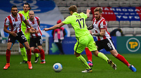 Lincoln City's Alan Power vies for possession with York City's Asa Hall<br /> <br /> Photographer Andrew Vaughan/CameraSport<br /> <br /> Buildbase FA Trophy Semi Final Second Leg - Lincoln City v York City - Saturday 18th March 2017 - Sincil Bank - Lincoln<br />  <br /> World Copyright &copy; 2017 CameraSport. All rights reserved. 43 Linden Ave. Countesthorpe. Leicester. England. LE8 5PG - Tel: +44 (0) 116 277 4147 - admin@camerasport.com - www.camerasport.com