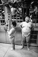 Young Rikishi Sumo competitors prepare for the opening ceremony..450 children, aged between 11-14, qualified for  the All Japan Wanpaku Sumo Tournament. The  Ryogoku Kokugikan Stadium, Tokyo, Japan.