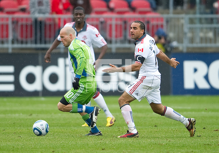 25 April 2010: Seattle Sounders midfielder Freddie Ljungberg #10 and Toronto FC midfielder Dwayne De Rosario #14 in action during a game between the Seattle Sounders and Toronto FC at BMO Field in Toronto..Toronto FC won 2-0....