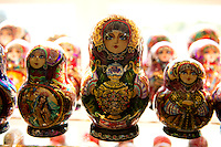 A matryoshka doll  also known as Russian nesting doll is a set of wooden dolls of decreasing size placed one inside the other. The first Russian nested doll set was carved in 1890 by Vasily Zvyozdochkin from a design by Sergey Malyutin, who was a folk crafts painter at Abramtsevo. Traditionally the outer layer is a woman, dressed in a sarafan, a long and shapeless traditional Russian peasant jumper dress. The figures inside may be of either gender; the smallest, innermost doll is typically a baby turned from a single piece of wood. Much of the artistry is in the painting of each doll, which can be very elaborate.