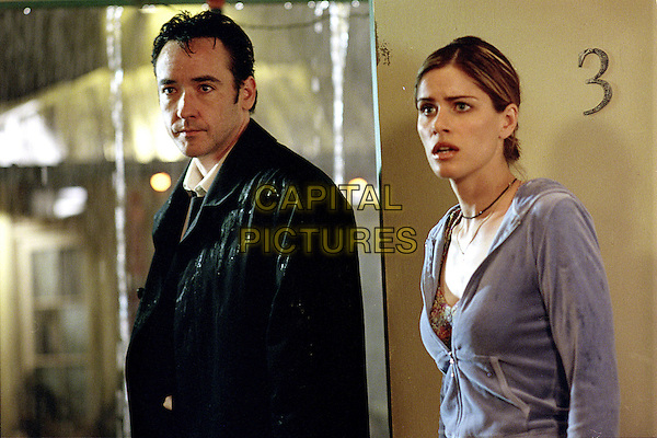 John Cusack & Amanda Peet.in Identity .*Filmstill - Editorial Use Only*.CAP/NFS.Supplied by Capital Pictures.