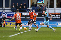 Paul Hayes of Wycombe Wanderers (right) sees his shot blocked by Sean Long of Luton Town (left) during the Sky Bet League 2 match between Luton Town and Wycombe Wanderers at Kenilworth Road, Luton, England on 26 December 2015. Photo by David Horn.