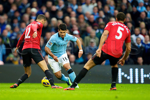 09.12.2012 Manchester, England. Manchester City's Argentinean forward Sergio Agüero, Manchester United's English defender Chris Smalling and Manchester United's English defender Rio Ferdinand in action during the Premier League game between Manchester City and Manchester United from the Etihad Stadium. Manchester United scored a late winner to take the game 2-3.