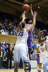 19 December 2013: Albany's Shereesha Richards (25) shoots over Duke's Haley Peters (33). The Duke University Blue Devils played the University at Albany, The State University of New York Great Danes at Cameron Indoor Stadium in Durham, North Carolina in a 2013-14 NCAA Division I Women's Basketball game. Duke won the game 80-51.