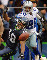 Oct 23, 2005; Seattle, Wash, USA;  Seattle Seahawks wide receiver #18 D.J. Hackett attempts to catch a pass under pressure from Dallas Cowboys cornerback #26 Aaron Glenn in the fourth quarter at Qwest Field. Mandatory Credit: Photo By Mark J. Rebilas
