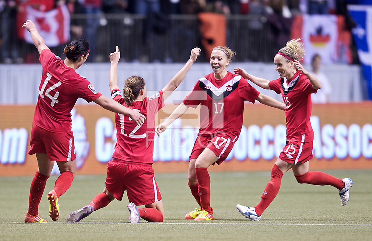 From left, Canada players Melissa Tancredi, Christine Sinclair, Brittany Timko and Kelly Parker celebrate defeating Mexico in the CONCACAF Olympic Qualifying semifinal match at BC Place in Vancouver, B.C., Canada Friday Jan. 27, 2012. Canada won the match 3-1 to earn a berth in 2012 London Olympics.