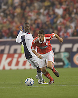 SL Benfica midfielder Filipe Menezes (24) accelerates away from New England Revolution forward Jean-Baptiste Fritzon (4). SL Benfica  defeated New England Revolution, 4-0, at Gillette Stadium on May 19, 2010.