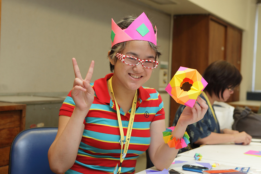 New York, NY, USA - June 24, 2012: Colorful member in a modular folding class. The OrigamiUSA 2012 Convention held at Fashion Institute of Technology, New York, attracts members from the USA with visitors from Asia, the Americas, and Europe. Attendees exhibit their work and take part in classes, and an exhibition of big folding.