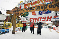 Race Officials Hang Banner @ Burled Arch Finish Line Nome 2005 Iditarod