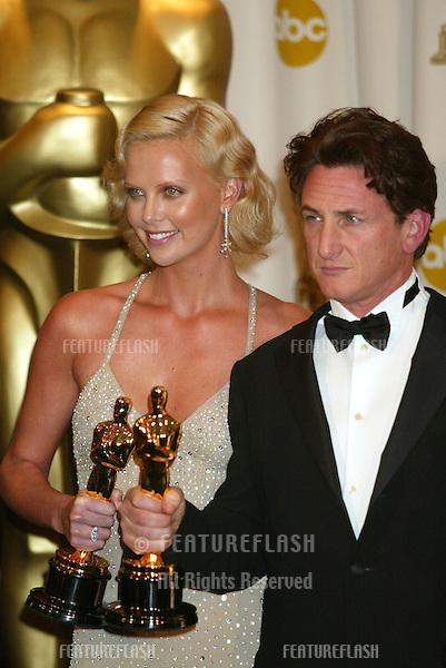 SEAN PENN & CHARLIZE THERON at the 76th Annual Academy Awards in Hollywood..February 29, 2004