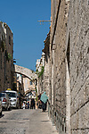 Lions' Gate Street in the Muslim Quarter of the Old City of Jerusalem.  The Old City of Jerusalem and its Walls is a UNESCO World Heritage Site.  The Ecce Homo Arch, with the window, is visible over the street.  It is part of the center of Hadrian's Arch.