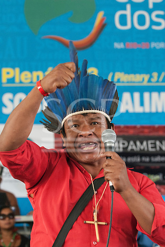 A Guarani leader from Mato Grosso do Sul speaks angrily at the indigenous forum about the plight of his people who have been badly affected by developments financed by BNDES, the Brazilian Development Bank. The People's Summit at the United Nations Conference on Sustainable Development (Rio+20), Rio de Janeiro, Brazil, 18th June 2012. Photo © Sue Cunningham.