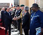 Egyptian President Abdel Fattah al-Sisi shakes hands with decorated staff officers in the company of Australian Governor-general Sir Peter Cosgrove at El Alamein War Cemetary, during a ceremony marking 75 years since the pivotal WWII battle in the Egyptian Mediterranean town of the same name, about 100 kilometres (62 miles) west of Alexandria on October 21, 2017. The World War II Battle of El Alamein -- which began on October 23, 1942 -- pitched the Allied forces of British Field Marshal Bernard Montgomery's against his German counterpart Erwin Rommel's Afrika Korps. Photo by Egyptian President Office