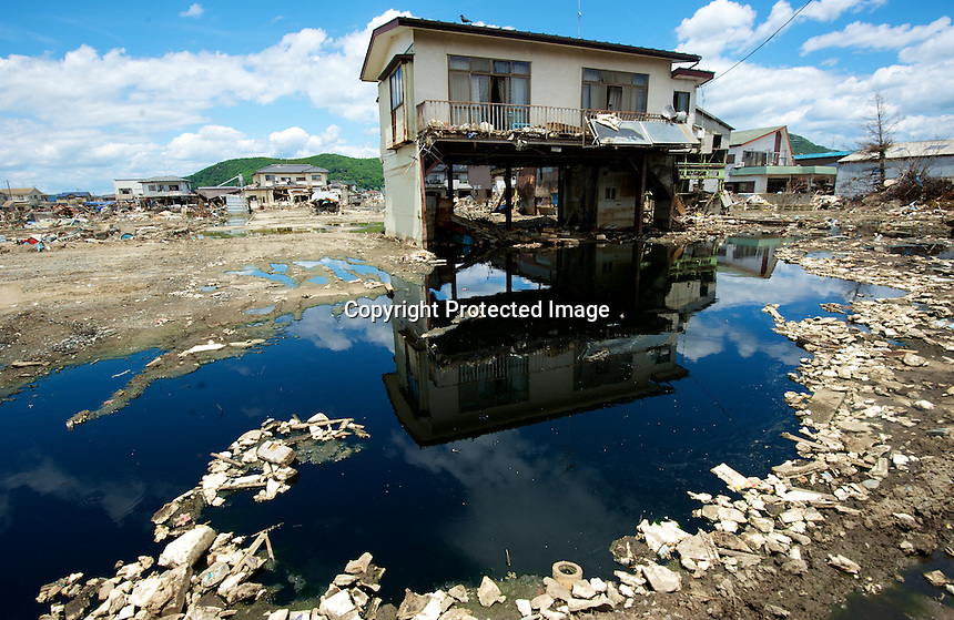Images that show Ishinomaki, that was devastated by the tsunami on 11th March 2011 photographed again 14th June 2011. 19th June will be 100 days since the earthquake.<br /> <br /> Photo by Richard Jones / Sinopix