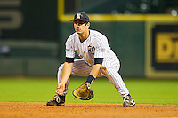 First baseman J.T. Chargois #14 of the Rice Owls on defense against the Texas A&M Aggies at Minute Maid Park on March 5, 2011 in Houston, Texas.  Photo by Brian Westerholt / Four Seam Images