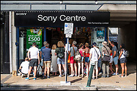 BNPS.co.uk (01202 558833)<br /> Pic: LeeMcLean/BNPS<br /> <br /> Sony TV centre proved popular....<br /> <br /> Sizzling Saturday in Bournemouth as football fever gripped the seaside resort, with fans havng to resort to peering in windows as all the bars were full.