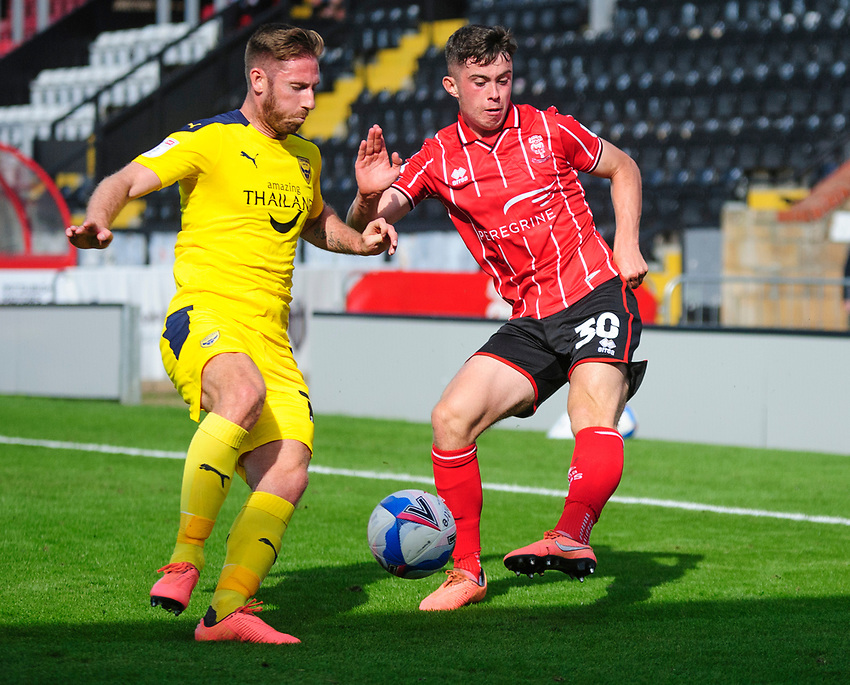 Lincoln City's Sean Roughan vies for possession with Oxford United's James Henry<br /> <br /> Photographer Andrew Vaughan/CameraSport<br /> <br /> The EFL Sky Bet League One - Saturday 12th September  2020 - Lincoln City v Oxford United - LNER Stadium - Lincoln<br /> <br /> World Copyright © 2020 CameraSport. All rights reserved. 43 Linden Ave. Countesthorpe. Leicester. England. LE8 5PG - Tel: +44 (0) 116 277 4147 - admin@camerasport.com - www.camerasport.com - Lincoln City v Oxford United