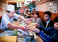 "Tokyo sushi chef serves his ""special"" as other customers enviously gaze on."