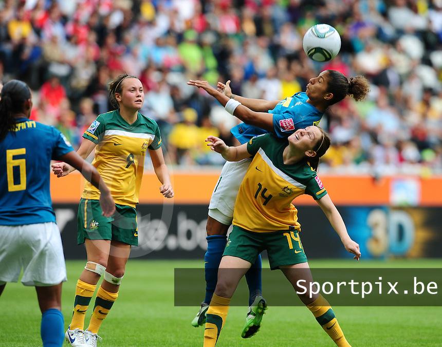 Fifa Women's World Cup Germany 2011 : Brazil - Australia  at Borussia - Park in Munchengladbach : Cristiane plukt de bal uit de lucht boven Collette McCallum. Caitlin Foord (links) kijkt toe.foto DAVID CATRY / Vrouwenteam.be