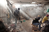 """Victorious Youth Group workshops in Kibera. The youth group, one of the stops on Octopizzo's """"Chocolate City"""" tours of Kibera, specializes in bone craft. They make jewelry, spoons and keychains from  discarded cow bones."""