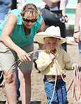Joseyray Funk gets last minute instructions before competing in the Pee-Wee Dummy Roping event at the Fallon Junior Rodeo.  Photo by Tom Smedes.