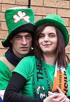 St Patrick's Day parade High Street Digbeth. Couple on slope of the Chapel House side of High Street