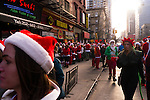 NEW YORK, NY - DECEMBER 13: Revelers dressed as Santa Claus during the annual SantaCon event December 13, 2014 in New York City. (Photo by Donald Bowers)