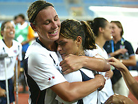 23 August 2004:  Abby Wambach hugs with Mia Hamm after USA defeated Germany in overtime during the semifinal game at Pankritio Stadium in Heraklio, Greece.     USA defeated Germany, 2-1 in overtime,  .   Credit: Michael Pimentel / ISI