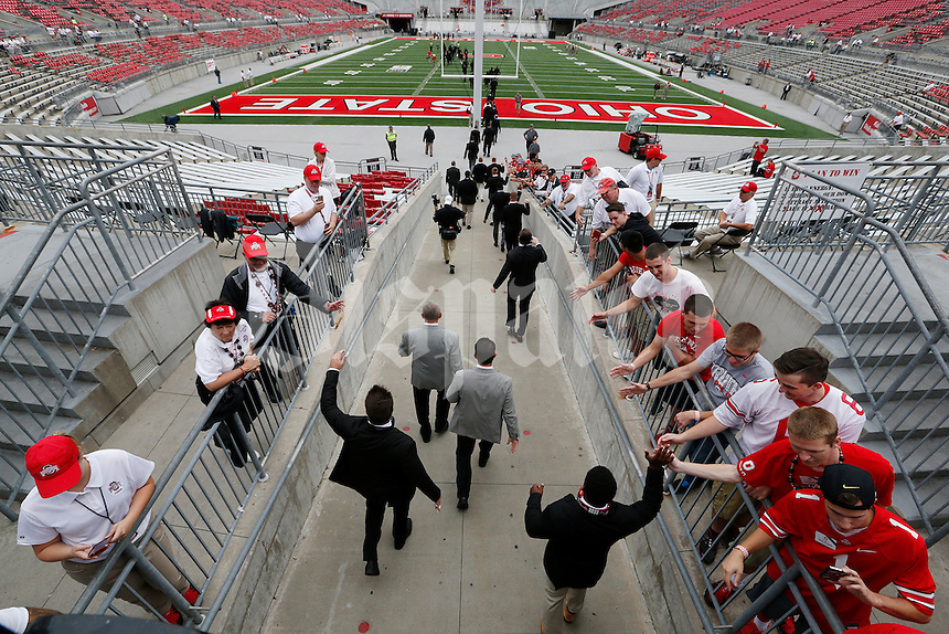 OSU football players arrive and head to the locker room before the start of an NCAA football game between the Ohio State Buckeyes and the Western Michigan Broncos  at Ohio Stadium in Columbus, Ohio, on Saturday, September 26, 2015. (Columbus Dispatch photo by Fred Squillante)