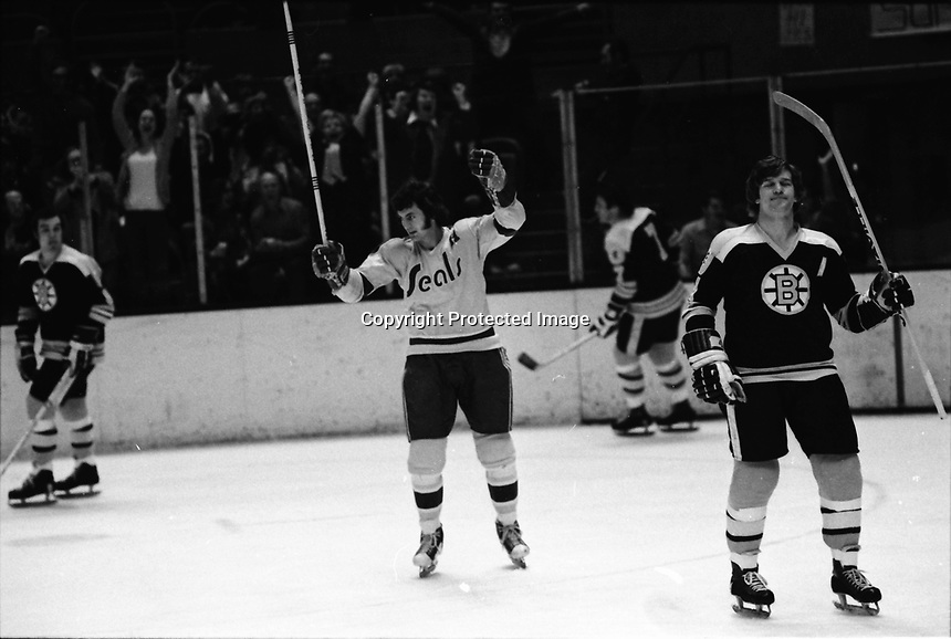 Seals Ivan Boldirev and Boston's Bobby Orr..photo/Ron Riesterer