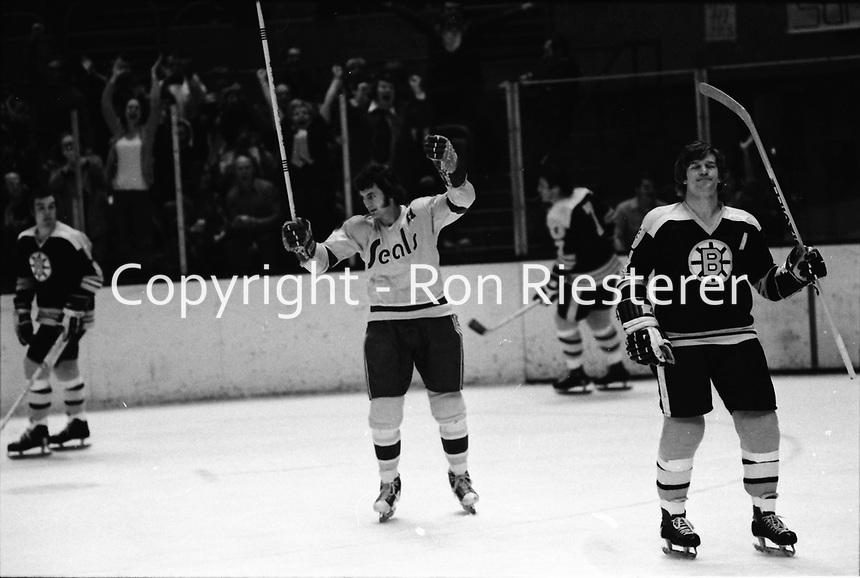 Seals Ivan Boldirev and Boston's Bobby Orr..photo/Ron Riesterer