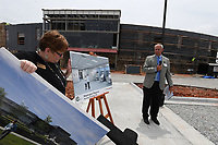 NWA Democrat-Gazette/J.T. WAMPLER Larry Shackelford, CEO of Washington Regional Medical Center (RIGHT) watches Tuesday June 5, 2019 as Treva Kennedy, associate director of development for Northwest Arkansas Community College unveils artists renderings for a new nursing studies area in the Washington County building under constructiuon in Springdale. WRMC has pledged one million dollars for nursing studies at the college.
